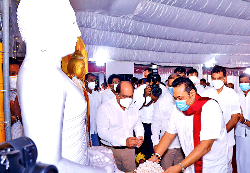 An alms giving to 76 mothers was held at Abhayaramaya temple in Narahenpita yesterday to mark Prime Minister Mahinda Rajapaksa's 75th birthday. Picture shows the Prime Minister offering a tray of flowers to the Buddha. Picture by Hirantha Gunathilake