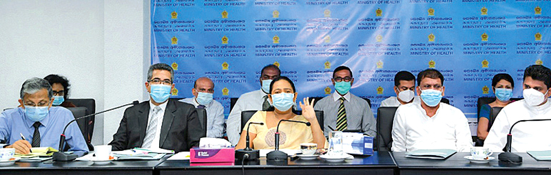 Minister of Health Pavithra Wanniarachchi, State Minister of Drug Production Channa Jayasumana, Secretary-General of Health Maj. Gen. Sanjeewa Munasinghe, and other officials at the meeting.