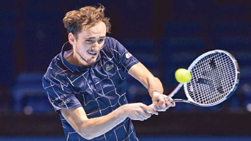 Russia's Daniil Medvedev returns to Serbia's Novak Djokovic during their men's singles round-robin match on day four of the ATP World Tour Finals tennis tournament at the O2 Arena in London on November 18. AFP