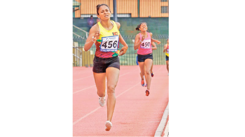 G.T.A. Abeyratne of SL Navy (456) won the women's 1500m event. Pictures by Jagath Iroshana