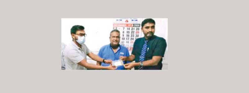 Dr K.L.M. Nagfer with team hands over the Suwa Dharani to Teemah Biscuits Managing Director M.C.M. Zubair.