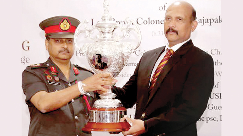 Defence Secretary Gen. (Retd) Kamal Gunaratne conferring the 'Late Brevet Col. G.W. Rajapakse Trophy' to the National Cadets Corps (NCC) to Director NCC Maj. Gen. Ruwan Kulathunga at a ceremony held at the NCC Headquarters Colombo on Thursday.