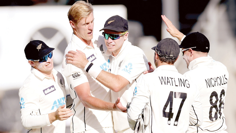 New Zealand's paceman Kyle Jamieson (2nd L) celebrates his wicket of Pakistan's batsman Faheem Ashraf with teammates on day one of the second cricket Test match between New Zealand and Pakistan at Hagley Oval in Christchurch on January 3.