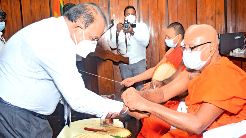 ANCL (Lake House) Chairman W. Dayaratne, PC receiving the blessings of the Maha Sangha. Pictures by Ranjith Asanka and Wasitha Patabendige