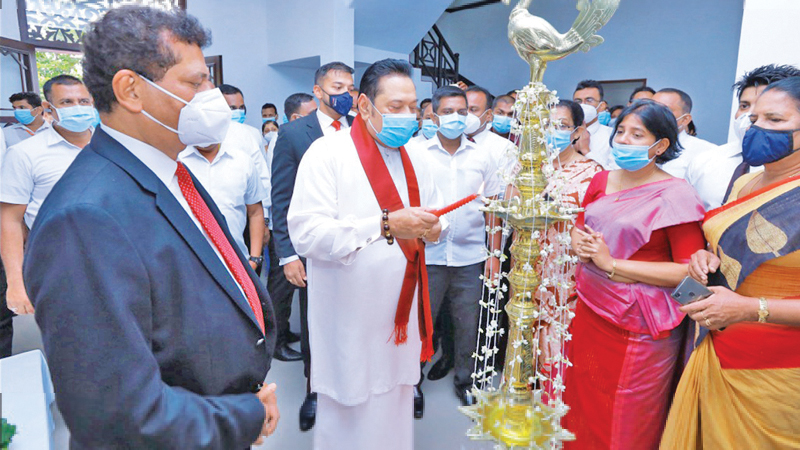 Prime Minister Mahinda Rajapaksa lighting the auspicious lamp at the opening of the refurbished PR Unit.