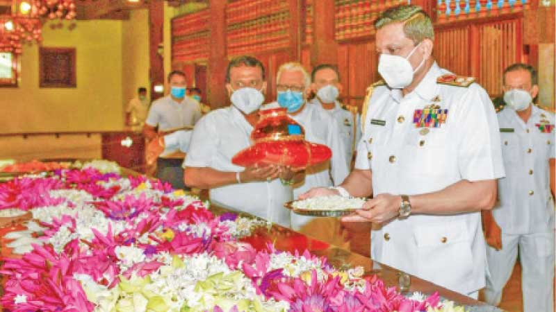 Navy Commander Vice Admiral Nishantha Ulugetenne at the Temple of the Sacred Tooth Relic in Kandy