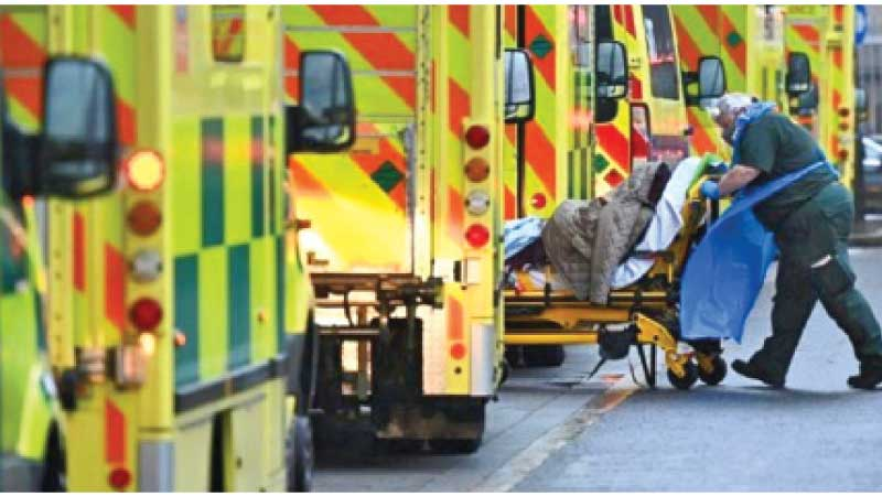 A COVID-19 patient been taken in to an ambulance at the Royal London Hospital Eemergency Department.