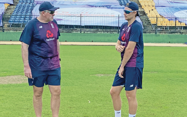 Coach Chris Silverwood (left) with Skipper Joe Root during a training session.