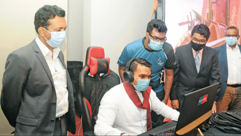 Sports and Youth Affairs Minister Namal Rajapaksa  explores the upgraded SLT Gaming & eSports Platform - slt.lk/esports - in the presence of officials from Sri Lanka Telecom and SLT Mobitel.
