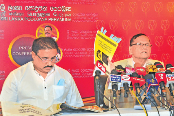 Education Minister G.L Peiris and Ports and Shipping Minister Rohitha Abeygunawardena at press conference held at the Water's Edge in Colombo yesterday.  Picture by Thushara Fernando