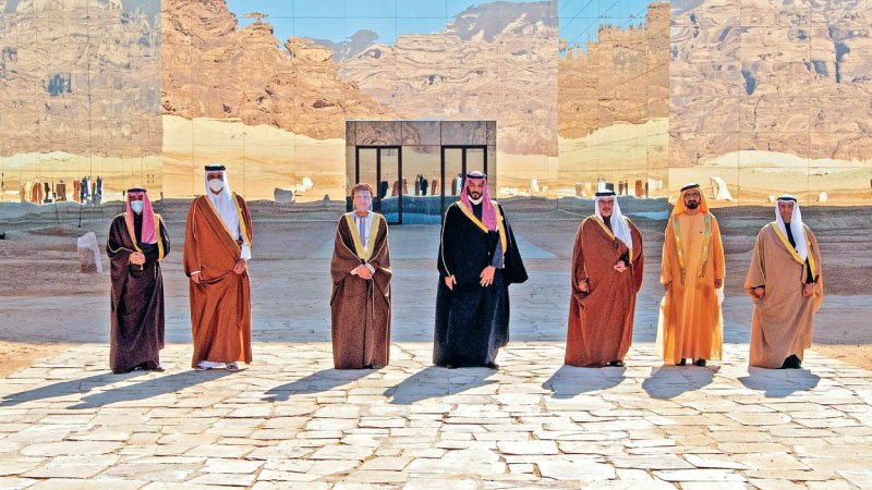 Gulf leaders pose for a picture before the opening session of the 41st Gulf Cooperation Council (GCC) summit that ended the rift between Qatar and the Saudi-led bloc, Al-Ula, Saudi Arabia, Janury 5, 2021. -AFP
