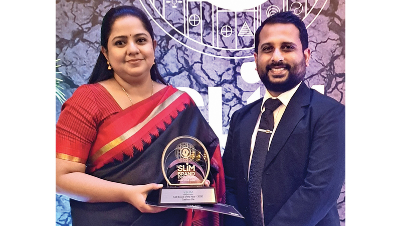 Nirusha Luxshumyraj and Chamath Alwis with the SLIM Brand Excellence award presented to the Company.