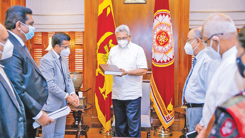 The Final Report of the Presidential Commission of Inquiry (PCoI) probing the Easter Sunday terror attacks was handed over to President Gotabaya Rajapaksa by its Chairman Supreme Court Justice Janak de Silva at the Presidential Secretariat yesterday. Members of the Commission, Secretary to the President Dr.P.B.Jayasundera and Principal Advisor to the President Lalith Weeratunga were present. Picture courtesy President's Media Division