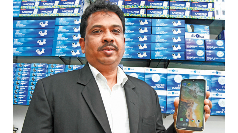 Chairman, Micro Electric Dhammika Samarawickrama with a Dummy of the HyPro phone