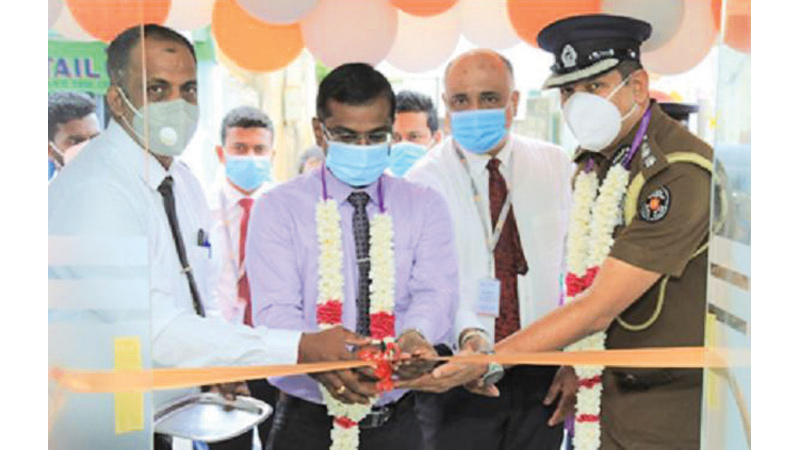 Additional District Secretory Trincomalee N. Pratheepan, Acting ASP Trincomalee Prasanna Bracmanage, Deputy General Manager Yasas Ariyarathna and Branch Manager K. Roopaharan at the Kurunegala People's Merchant Finance branch relocation ceremony.