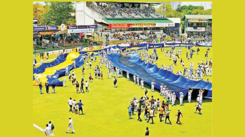 A parade by schoolboys during the lunch break of a recent Royal - Thomian big match at the SSC grounds