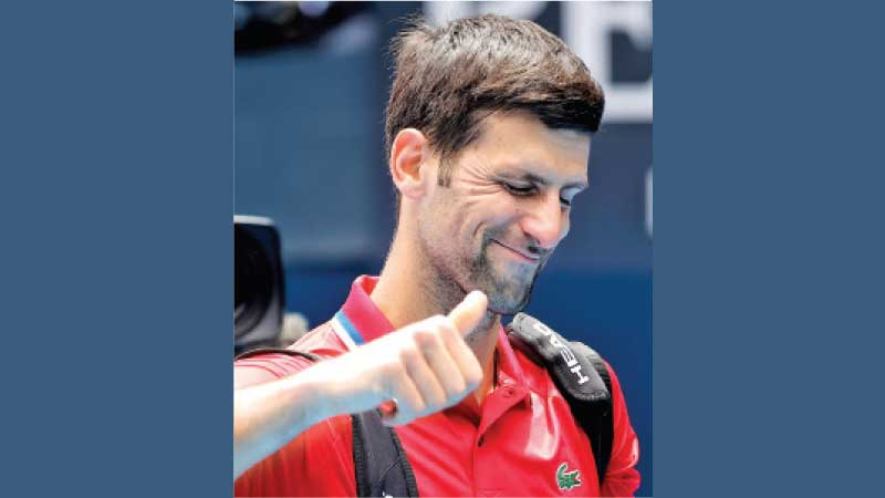 Serbia's Novak Djokovic gestures as he leaves after winning his group A men's singles tennis match