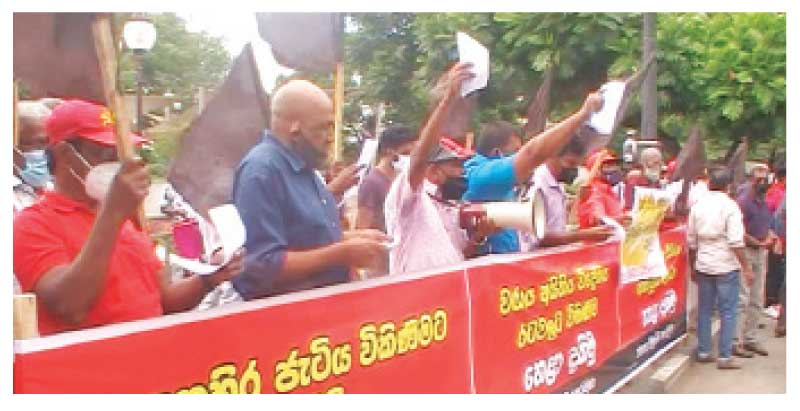 The People's Liberation Front staged a protest in front of the George E. de Silva Park in Kandy on Monday over the government's plans to hand over the Colombo Port's East Container Terminal to the Adani Company. Picture by J.M. Hafeez, Akurana Group Corr.