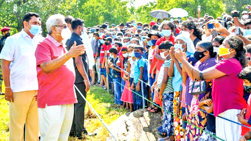 """President Gotabaya Rajapaksa interacts with people during the 8th 'Discussion with the Village"""" programme near the Kukulkatuwa tank in the Thanamalwila Aluthwewa Grama Niladhari Division, Monaragala last Saturday. Picture courtesy President's Media Division"""