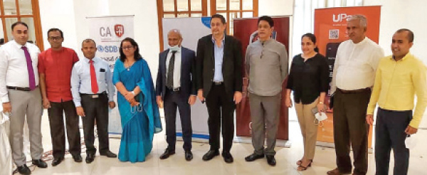 Manil Jayesinghe, President of CA Sri Lanka, Sanjaya Bandara, Vice President of CA Sri Lanka and Lakshman Abeysekera, Chairman of the SME Task Force flanked by officials of CA Sri Lanka and SDB