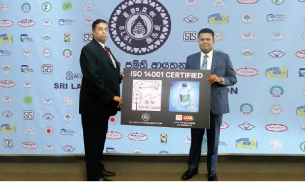Dr. Nushad Perera, Chairman of Sri Lanka Standards Institution hands over the ISO 14001:2015 – EMS certification to Mangala Perera Executive Director of C.W. Mackie Group