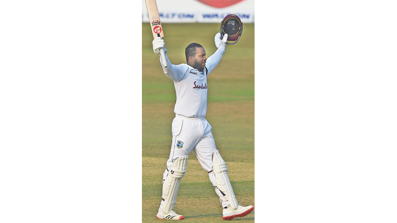 West Indies' Kyle Mayers celebrates after scoring a double century during the fifth day of the first Test match against Bangladesh in Chittagong on Sunday. - AFP