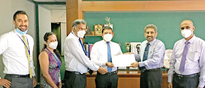 Handing over the cheque for the claim by officials.