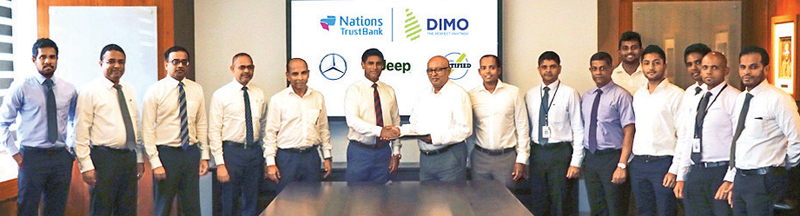 Officials of DIMO and Nations Trust Bank exchange the partnership.