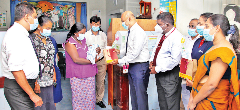 A People's Bank 'Isuru Udana' gift voucher gifted to a baby born at Colombo South Teaching Hospital by Clive Fonseka of People's Bank.