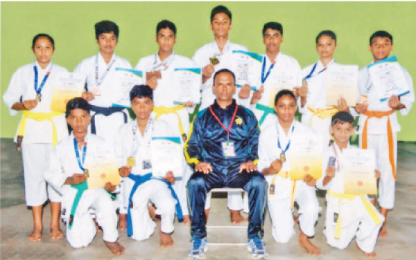 ISKU Karate Academy participants posed for a photograph with their coach Sugath Kumara after winning the National Championship of Karate-Do Federation. Squatting in the front row first from left is Wishva Dimantha. (Picture by Dilwin Mendis Moratuwa Sports Special Correspondent)