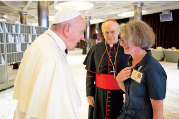 Pope Francis in conversation with Xaviere Missionary Sister Nathalie Becquart who is the the first female to be appointed as an undersecretary of the Synod of Bishops in the Vatican.