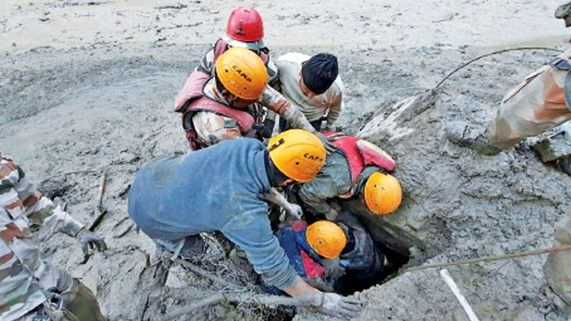 Members of the Indo-Tibetan Border Police (ITBP) during a rescue operation after a broken glacier caused a major river surge that swept away bridges and roads, at Reni village in Chamoli district of Uttarakhand. - AFP