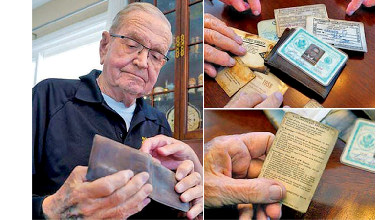 Former Navy meteorologist Paul Grisham with the wallet he recovered after 53 years.