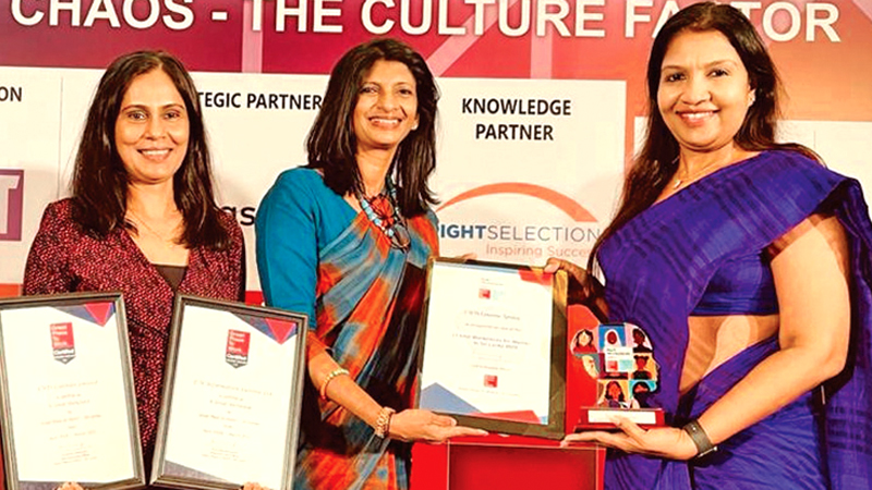 EWIS Director Roseanne Wijayanayake and General Manager Shaharin Nadesapillai receives the 'Best Workplace for Women' award