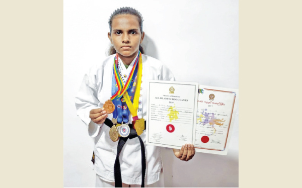 Uthpala Kavindi Chandrapala is seen here with her medals