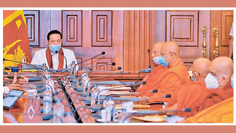 Prime Minister Mahinda Rajapaksa meeting the Maha Sangha yesterday. Picture by PM Media.