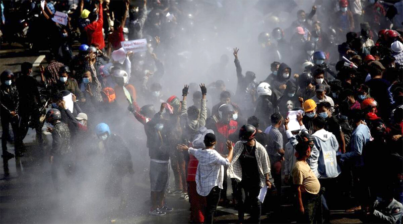Police in Myanmar crack down on crowds defying protest ban.