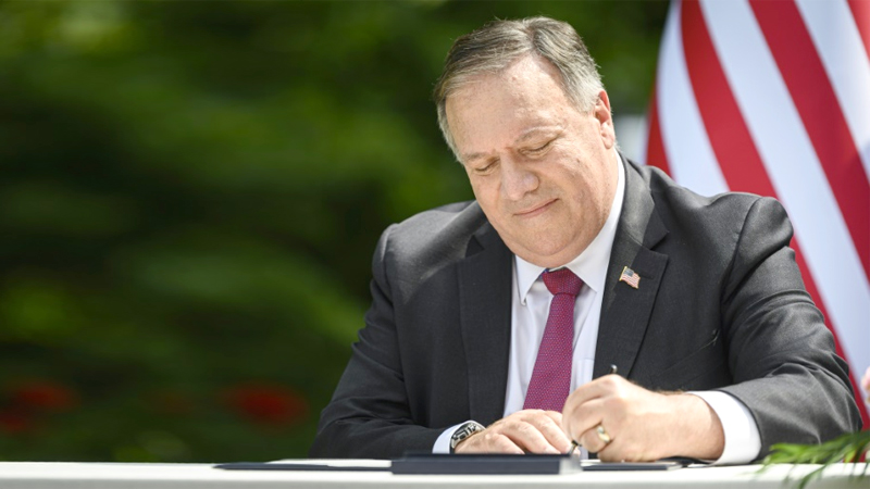 Former US Secretary of State Mike Pompeo, signing an agreement on an August 2020 visit to Slovenia.