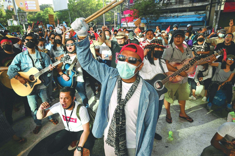 Musicians take part in a protest against the military coup in Yangon, Myanmar on Thursday. - AFP