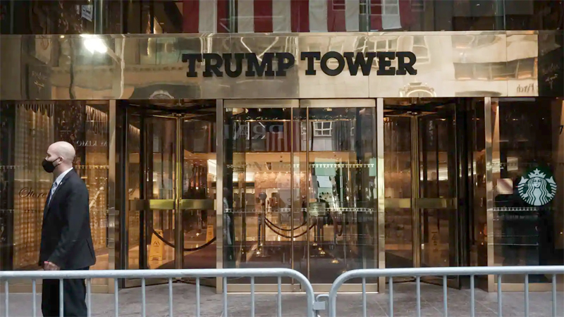 A man walks past the barriers placed opposite the Trump Tower in New York on Wednesday. - AFP