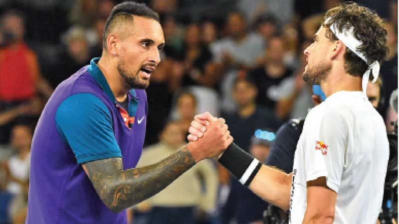 Austria's Dominic Thiem (R) and Australia's Nick Kyrgios greet each other after their men's singles match on day five of the Australian Open. - AFP