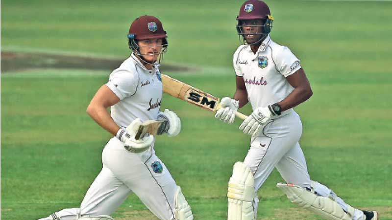 West Indies' Joshua Da Silva (L) with teammate Nkrumah Bonner run between the wickets during the second day of the second Test match against Bangladesh. - AFP
