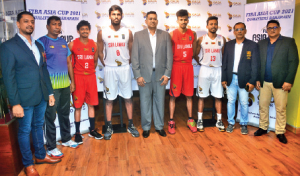 Some of the Basketball National team players pose for a  photograph along with the sponsors, team and Federation officlals. (Picture by Ranjith Asanka)