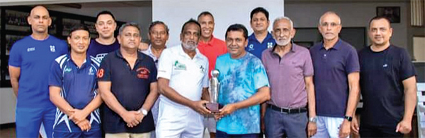 The Skipper of the  Thomian Masters team Deepal Ahangama receiving the Ranil Abeynaike Memorial Trophy from Amitha Abeynaike. Picture by M H.YAKEEM