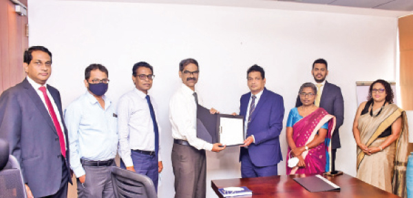 Darshan Perera – CEO of NDB Investment Bank, Shameer – Country Head of Indian Overseas Bank, K Raveendran – Senior DGM – NSB, Basheer Ahamed – Chief Executive Officer of Indian Bank, Ajith Peiris – GM/CEO of NSB, Christine Jesudian – DGM ( Credit & International Banking ) NSB, Dilip Samanthilake –  Senior Director Alpen Capital (ME) ltdand Kaushini Laksumanage– COO of NDB Investment Bank exchanges the agreement