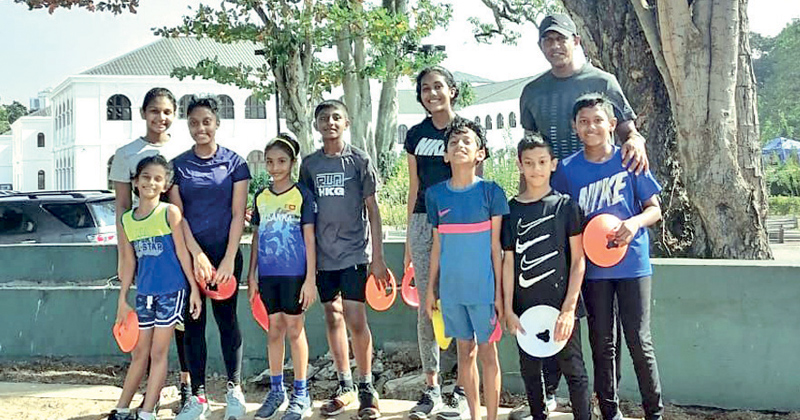 Ranga Wimalawansa with some of the young athletes