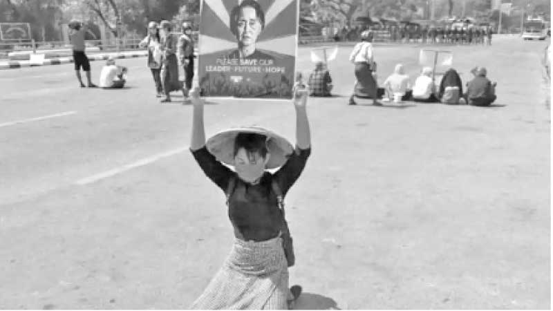 A protester holds up a sign calling for the release of detained Myanmar civilian leader Aung San Suu Kyi during a demonstration against the military coup in Naypyidaw on Tuesday.