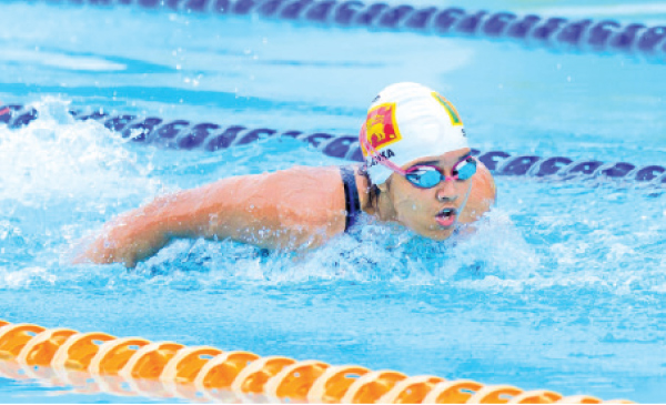 Madara Jayaratne in action at a Swimming meet.   ( Pictures. by Upananda Jayasundera-Kandy Sports Spl.Corr