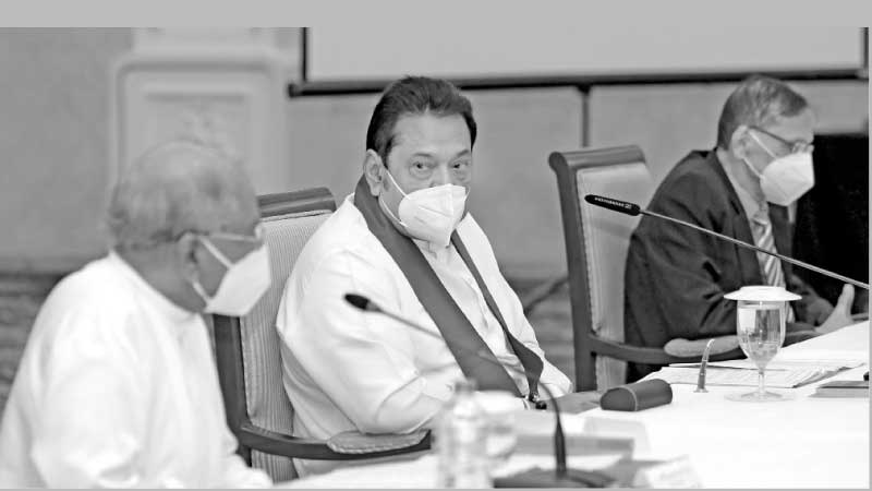 Prime Minister Mahinda Rajapaksa along with Foreign Minister Dinesh Gunawardene and Education Minister Prof. G L Peiris at the inaugural meeting.