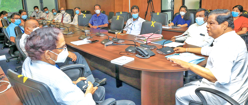 Minister Bandula Gunawardena discussing the project with the officials.